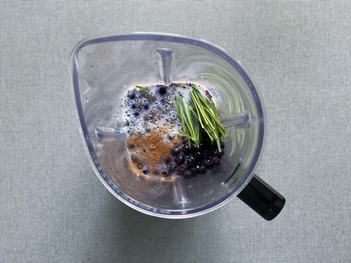 ingredients for blueberry chia smoothie recipe in the pitcher of a blender