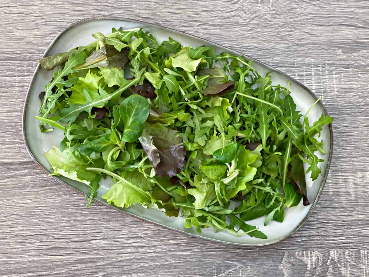 salad greens on a serving tray