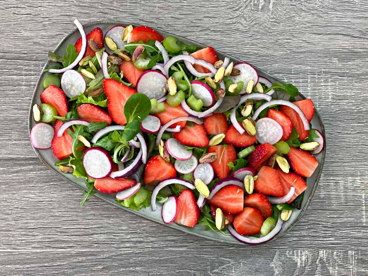 sliced onions, sliced radishes, sliced celery and roasted pistachios added to salad