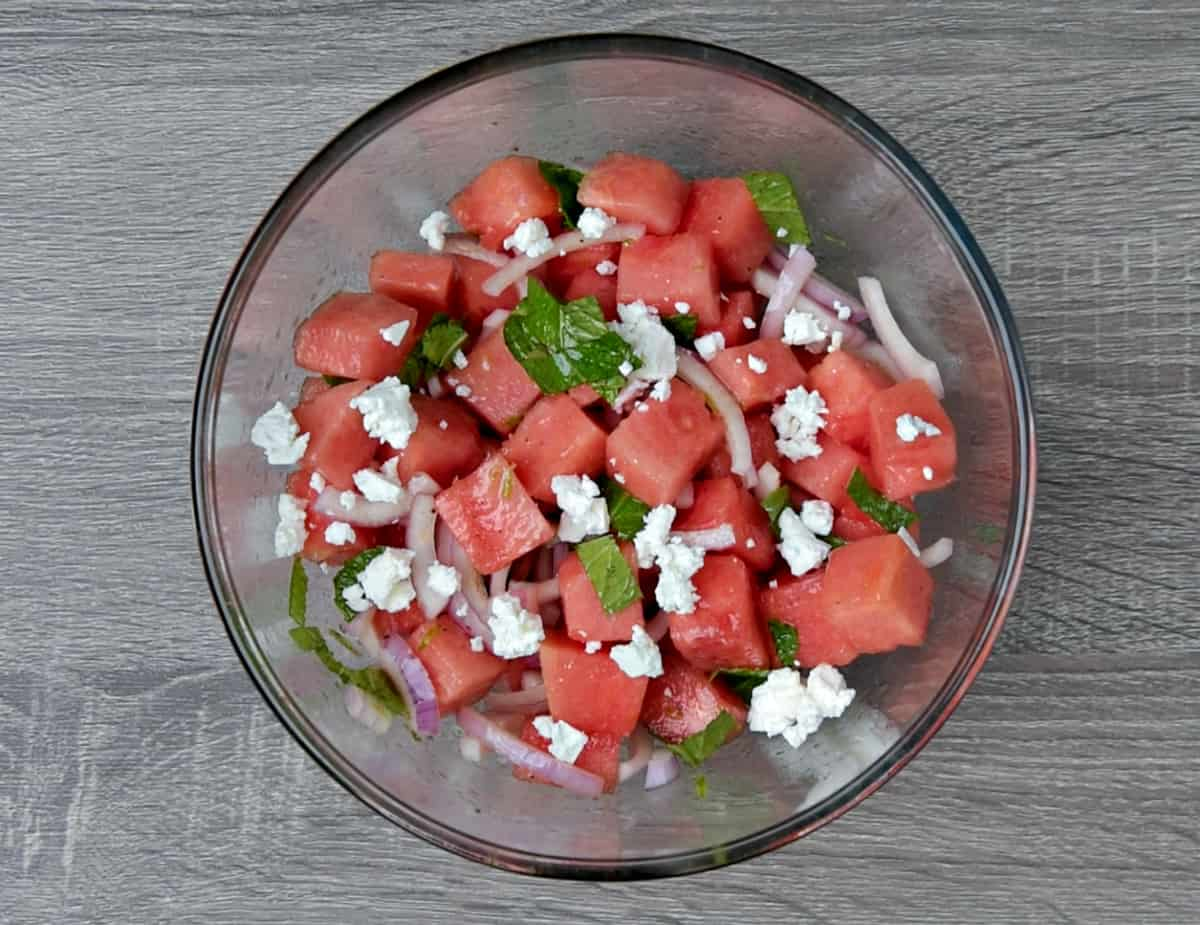 completed watermelon feta salad in mixing bowl