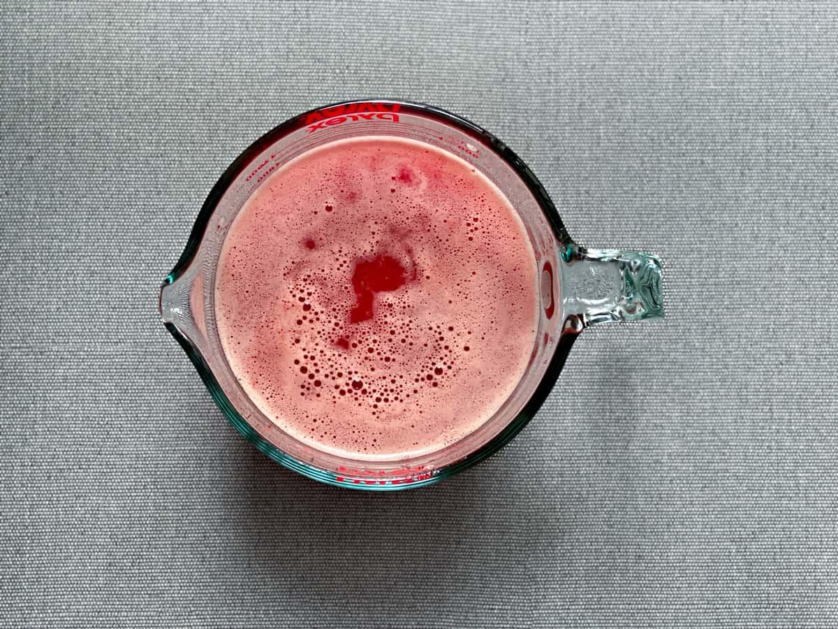 watermelon strawberry lemonade in a glass pitcher