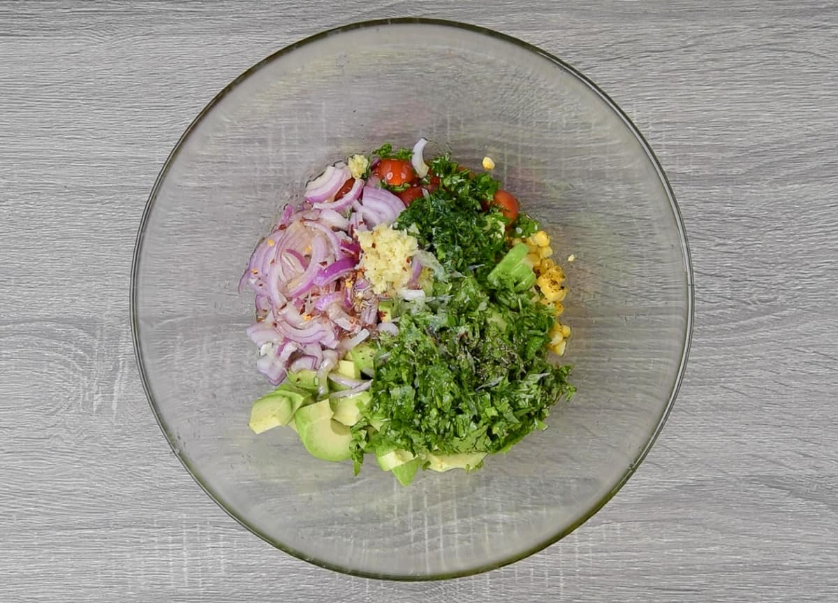 sliced onion, chopped cilantro, parsley, minced garlic, seasonings, and olive oil added in bowl