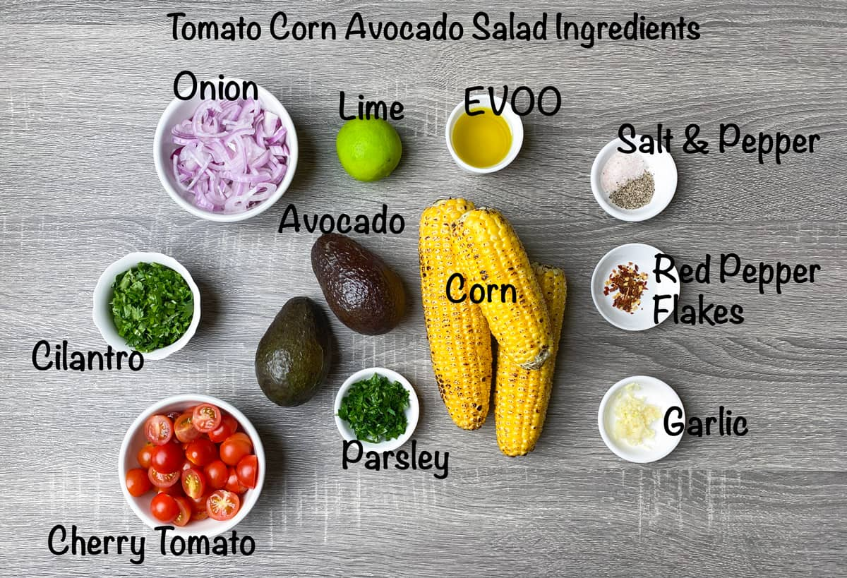ingredients for avocado corn salad recipe placed in bowls and laid on grey table