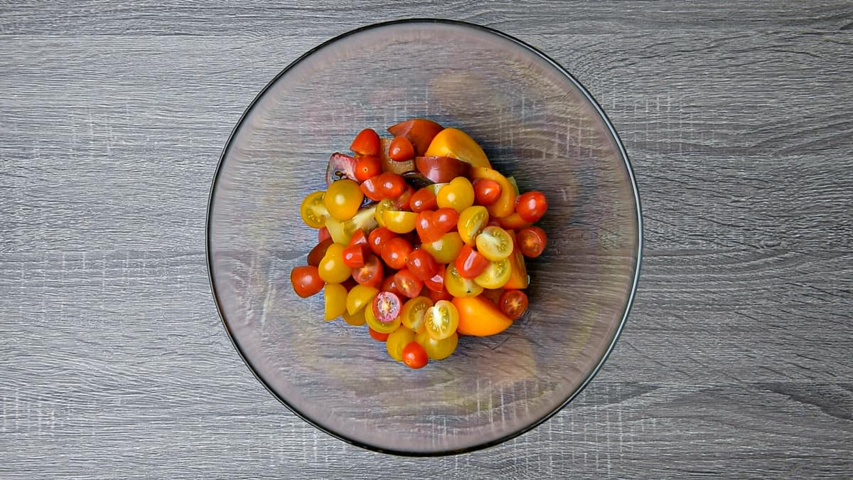 sliced tomatoes and halved cherry tomatoes in a bowl