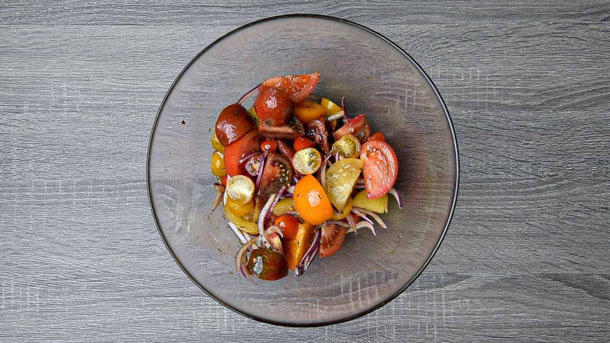 tomatoes, onions and dressing tossed together