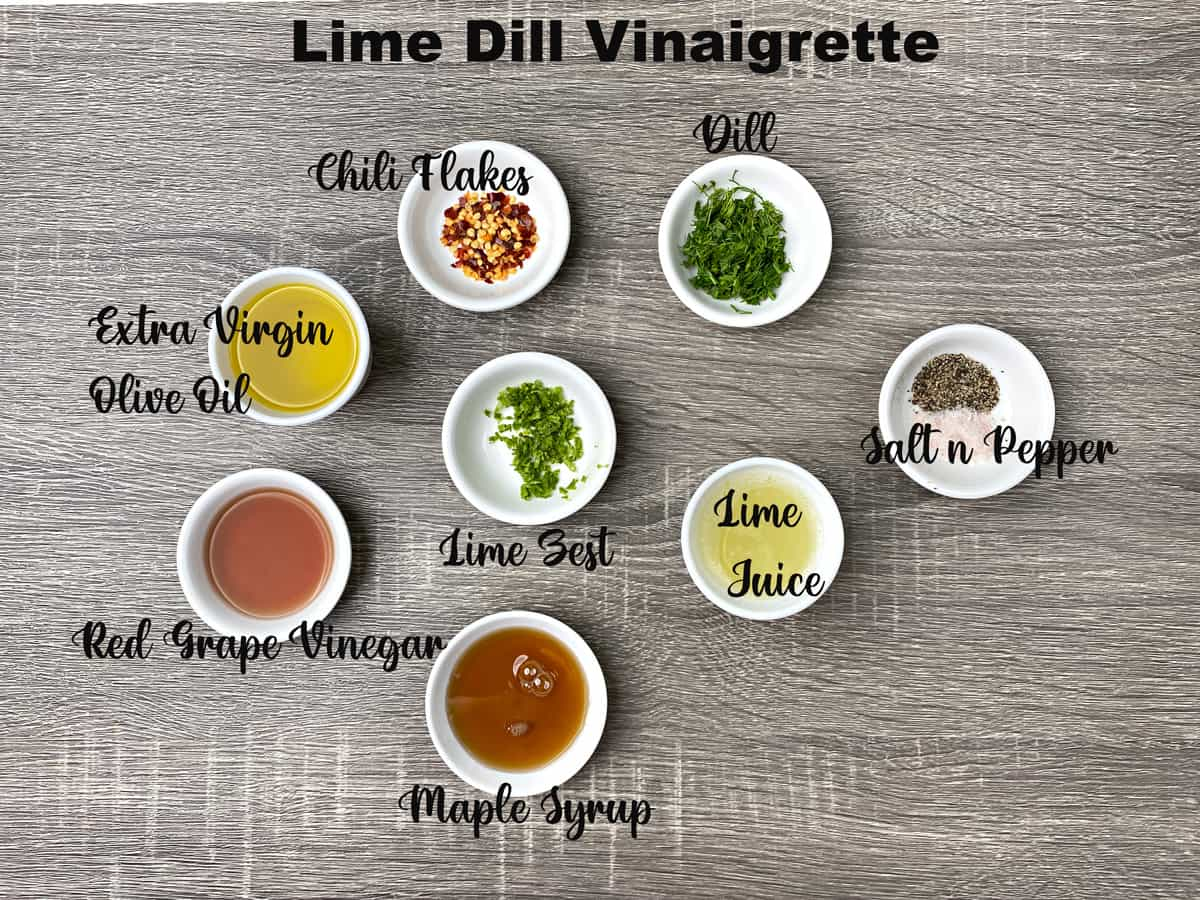 ingredients for lime dill vinaigrette measured out in small white bowls