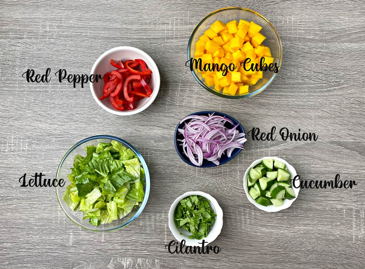 produce needed for mango salad recipe laid out on a table