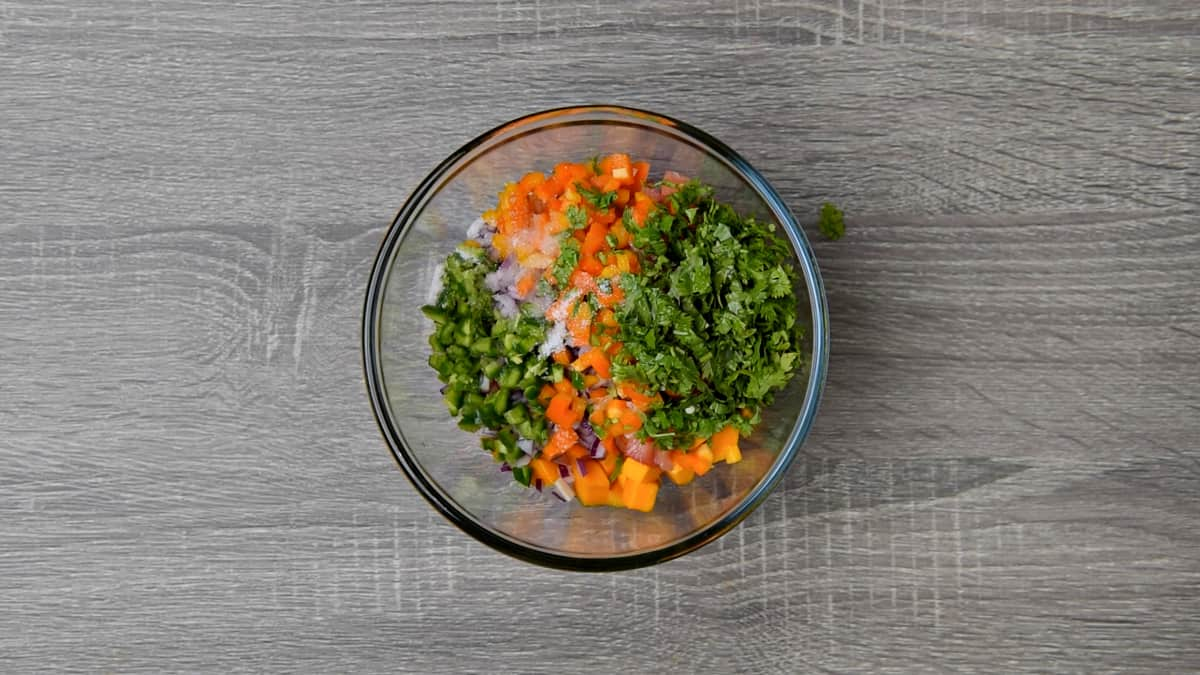 sweet peppers, jalapeño, cilantro, lime juice, and salt added to bowl with salsa ingredients