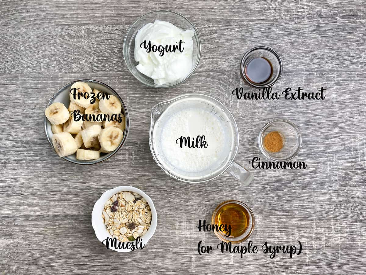 ingredients for making healthy breakfast smoothies measured out into bowls on a table