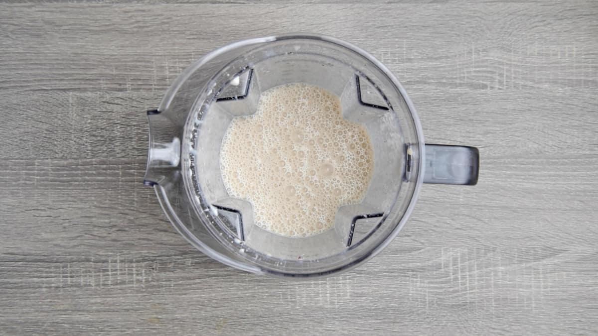 blended breakfast smoothie in blender pitcher