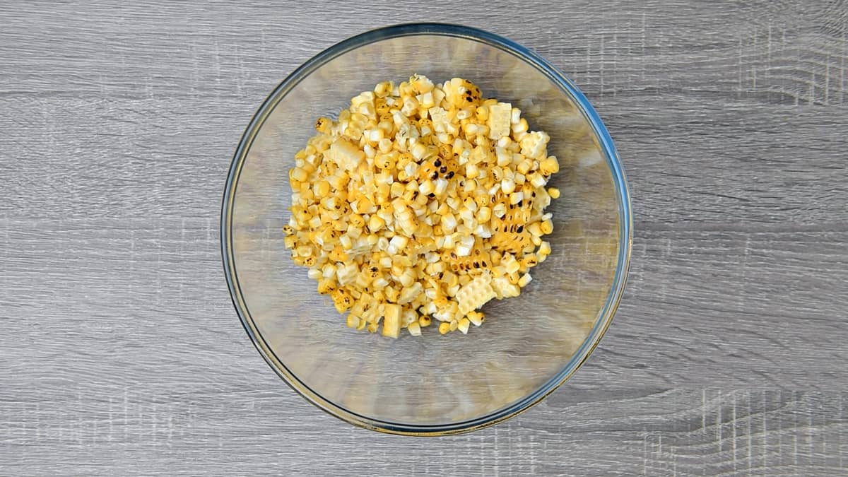 roasted corn kernels removed from the cob and added to a clear mixing bowl