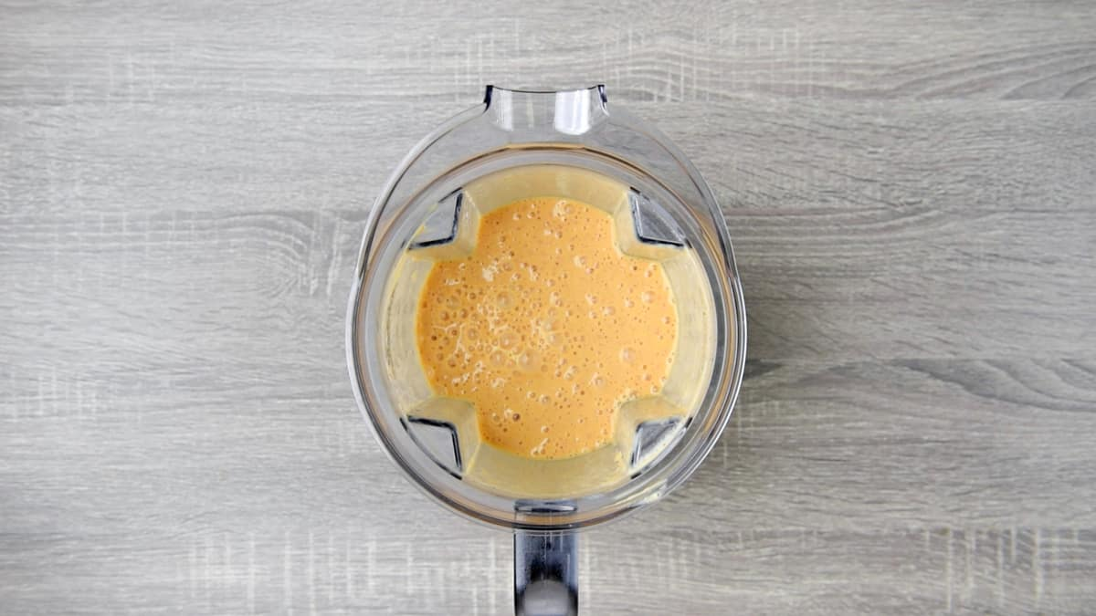 mango peach smoothie in pitcher after blending