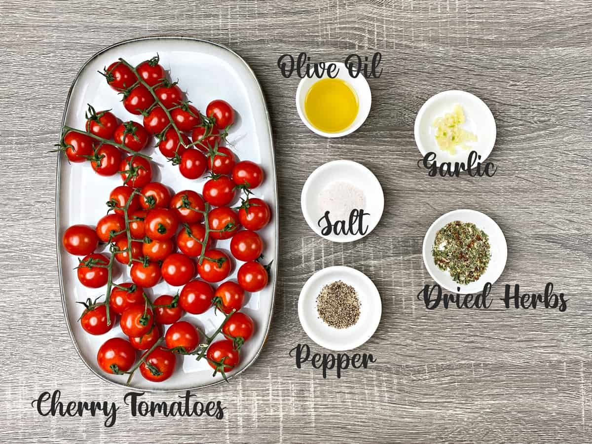 ingredients for making roasted cherry tomatoes placed in bowls