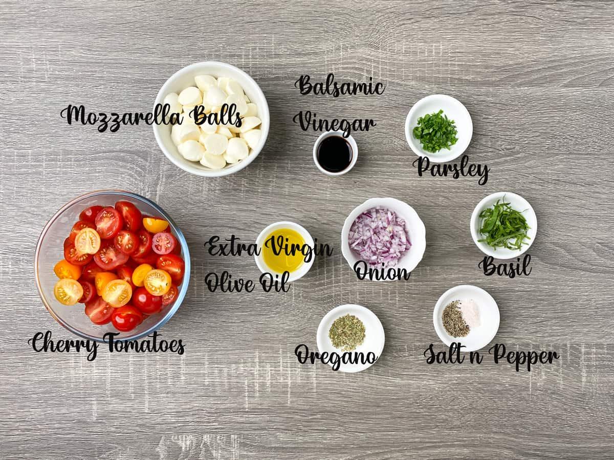 ingredients to make tomato mozzarella salad measured out into bowls