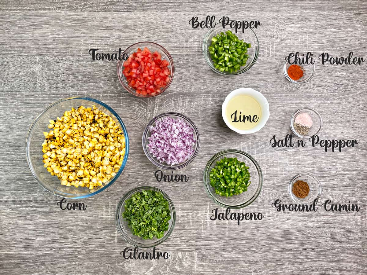 ingredients for making fresh corn salsa measured out into bowls