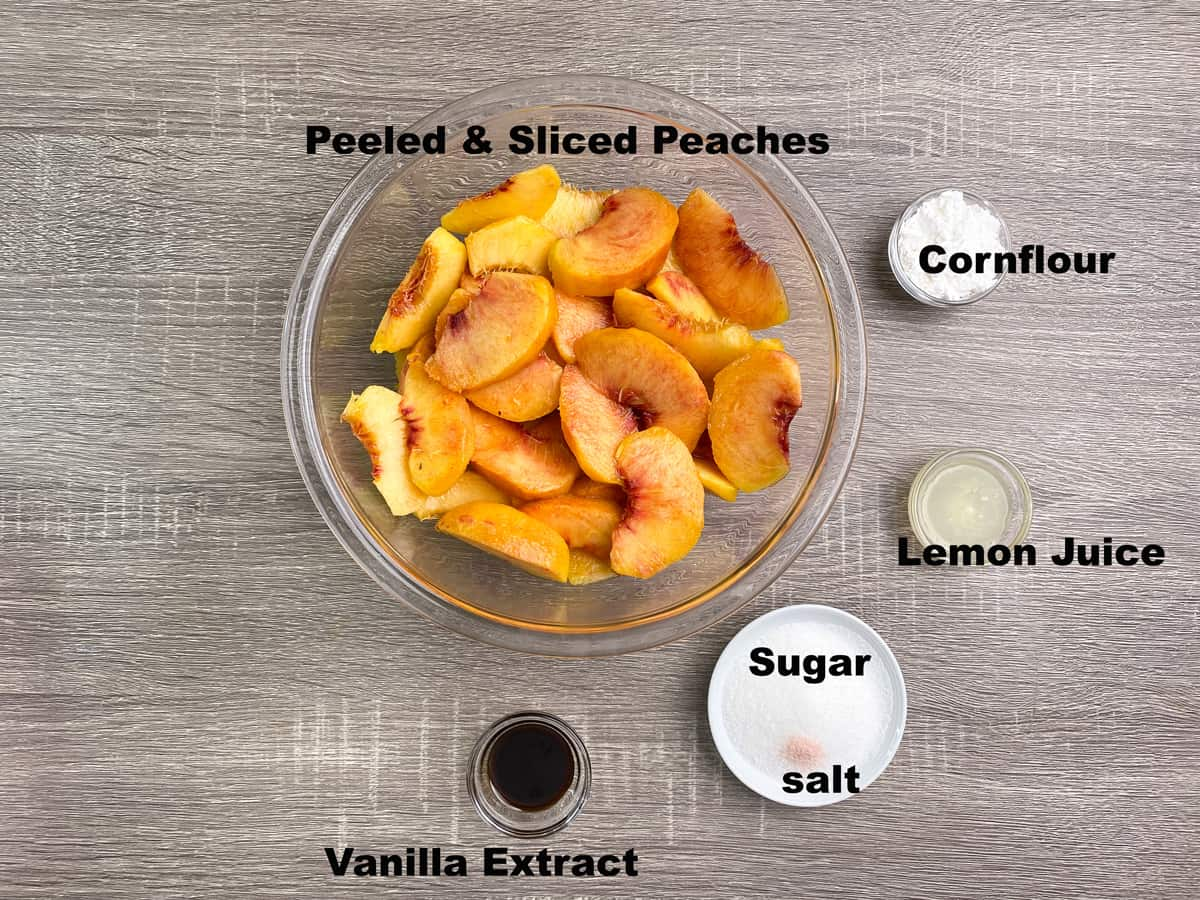ingredients for peach crisp filling measured out into bowls