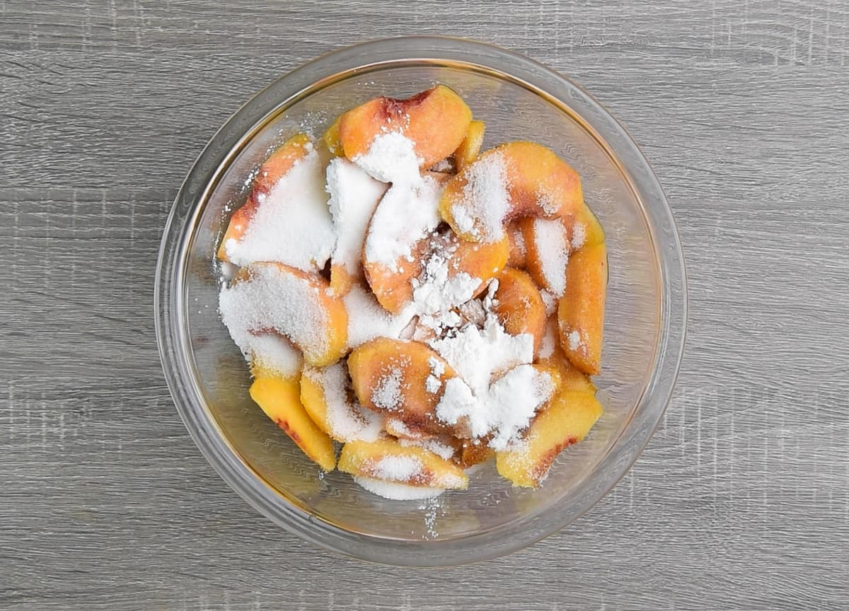 peach filling ingredients added to a mixing bowl