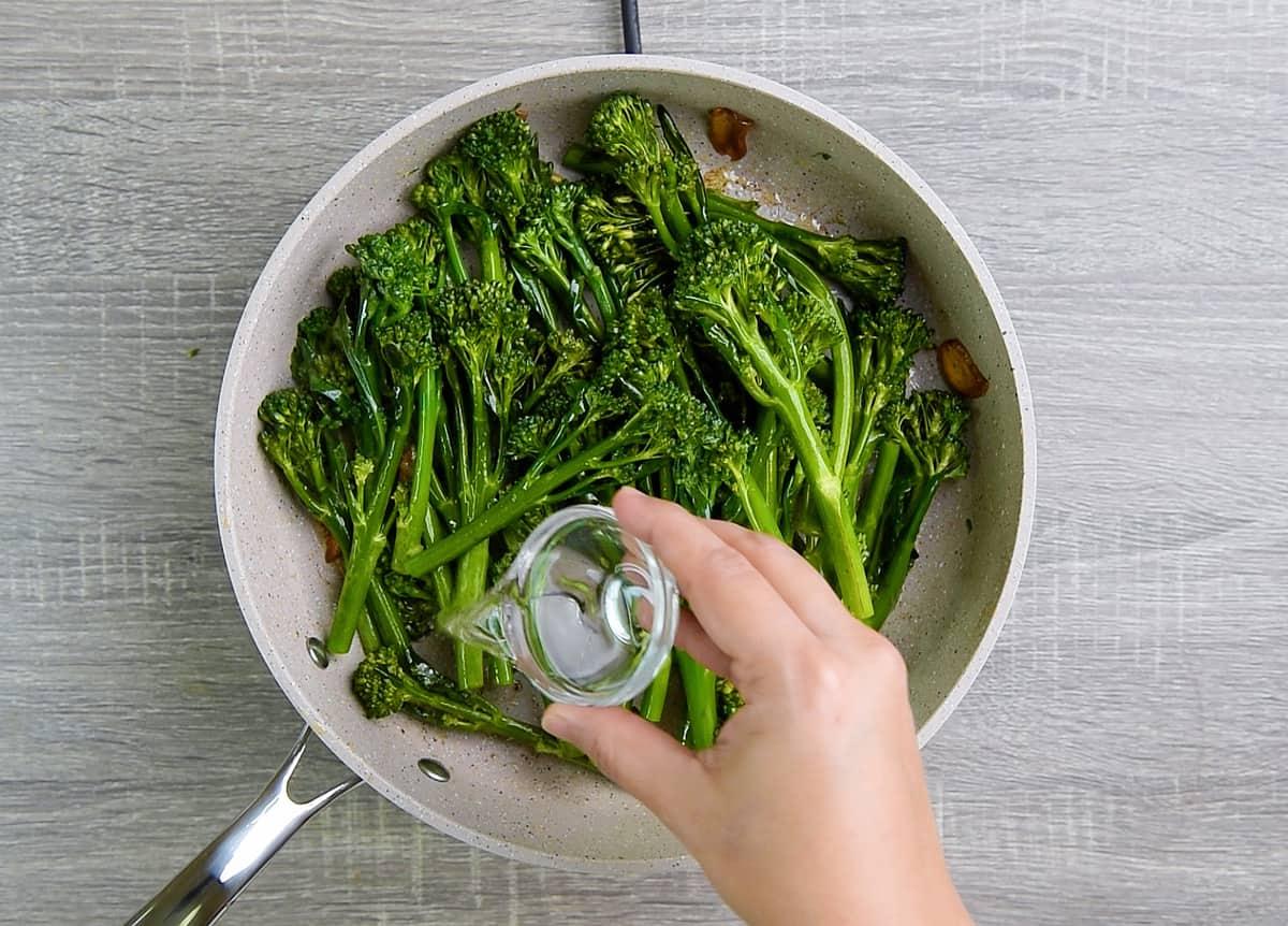 adding water to steam broccolini