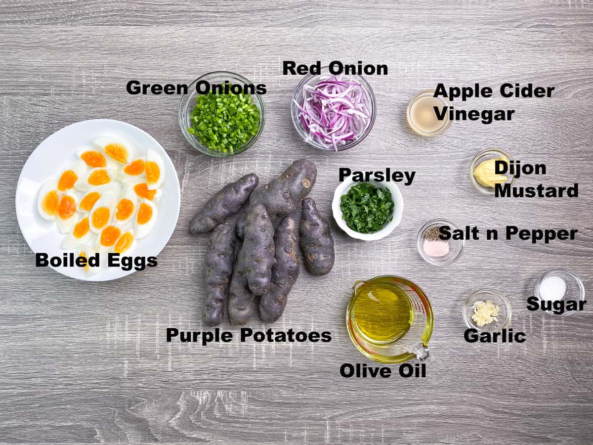 ingredients for warm purple potato salad recipe measured out into bowls